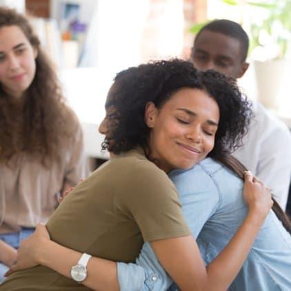 women giving a hug