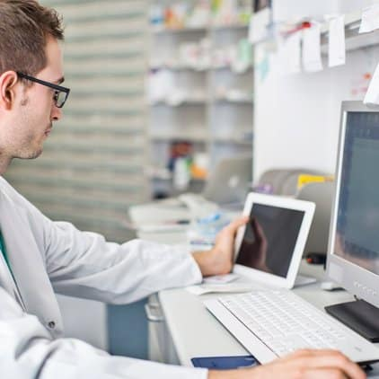Pharmacist at computer