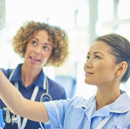 Nurses preparing IV
