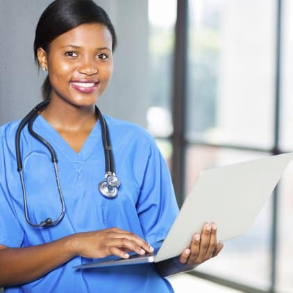 Nurse holding laptop