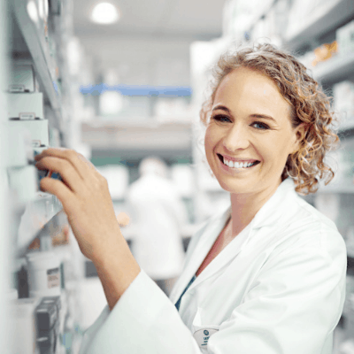 Pharmacist looking at computer